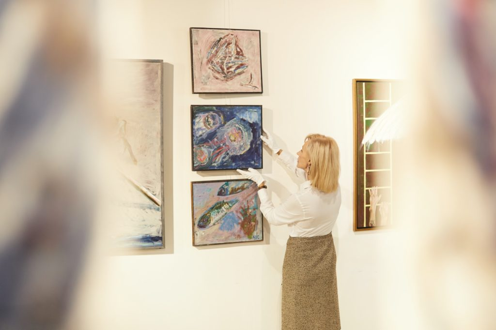 Art Gallery Manager Hanging Paintings