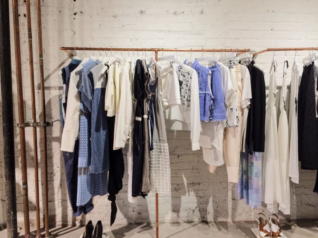 Clothing on the rail in the pop up store
