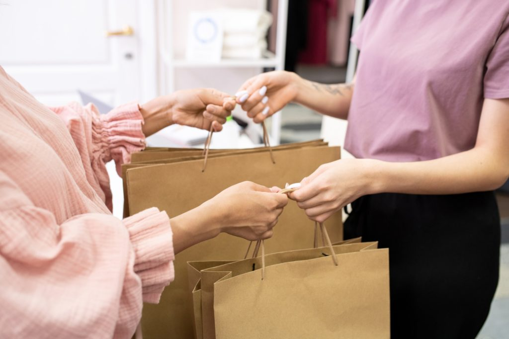 Customer buying clothes in the shop
